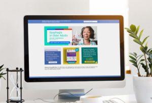 ASHA website mocked up on a computer screen.