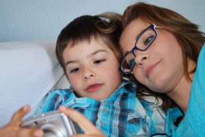 mother-and-son-looking-at-photos