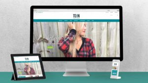 Torn Boutique's shopify site on mobile and desktop.